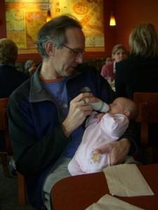 Grandpa feeding Josie