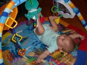 Josie kicking her toy