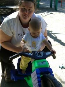Josie on someone\'s big wheel