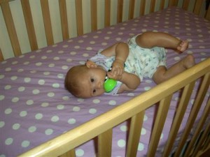 Josie in her crib