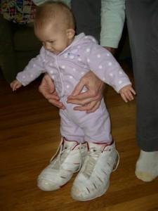 Josie in grandpa\'s shoes
