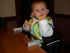 Josie eating apples in her new chair