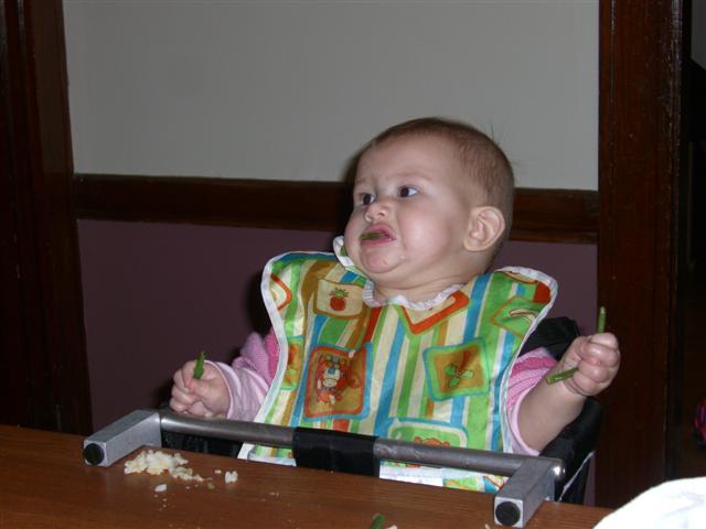 Josie eating green beans