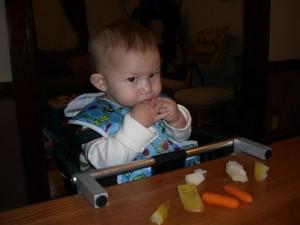 Josie coyly eating her pears