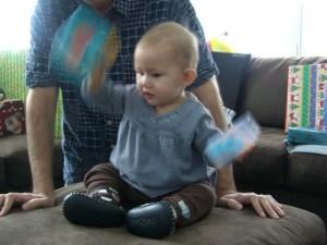 Josie shaking her toys