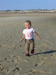 Josie running on the beach