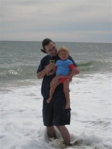 Jordi holding Josie at coast guard beach