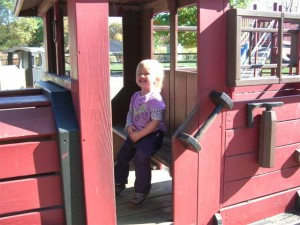 Josie in the firetruck at the zoo