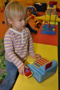 Josie playing with the cash register