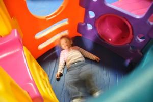 Josie wiggling on the floor