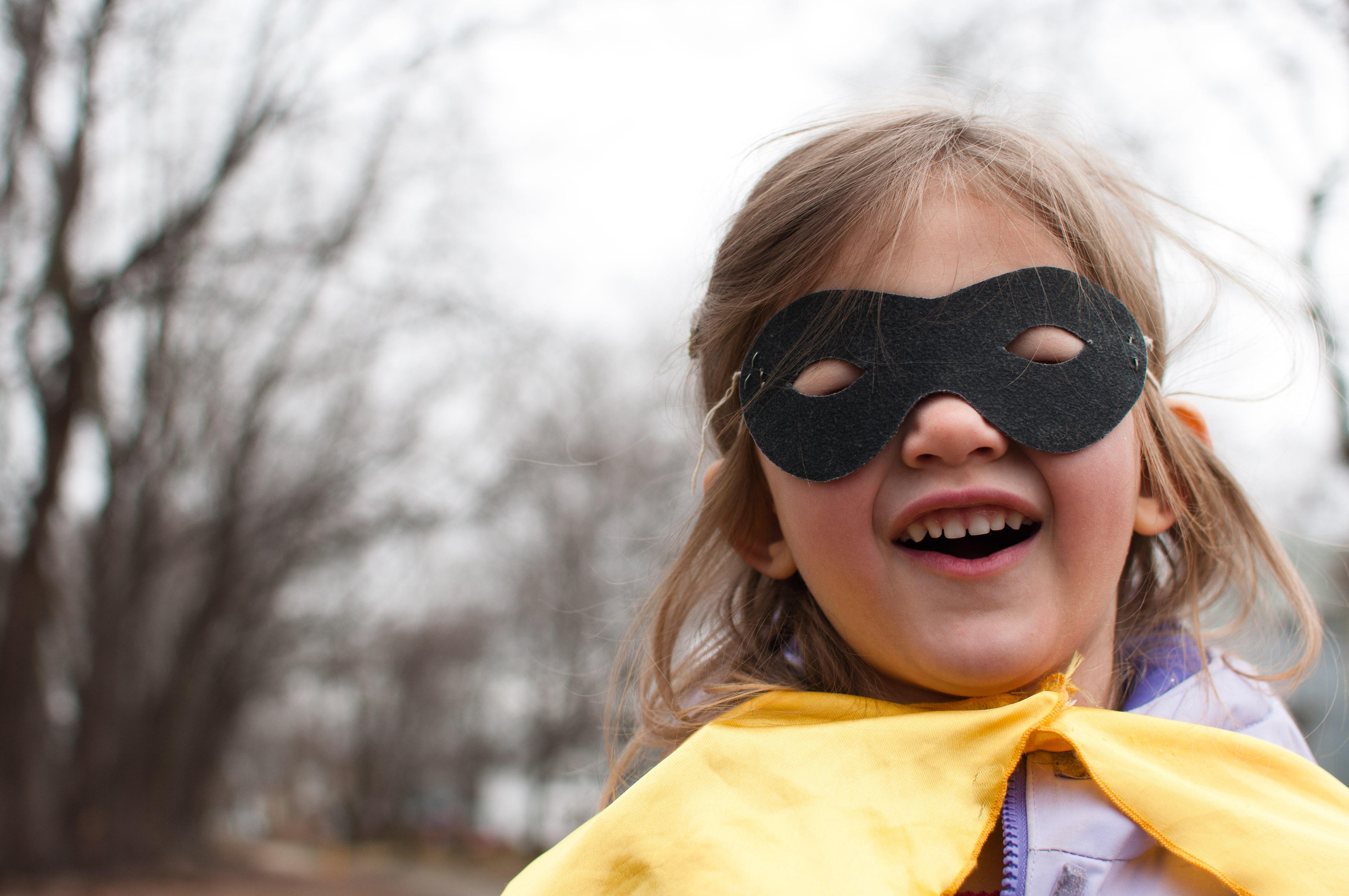 A superhero must hide her identity
