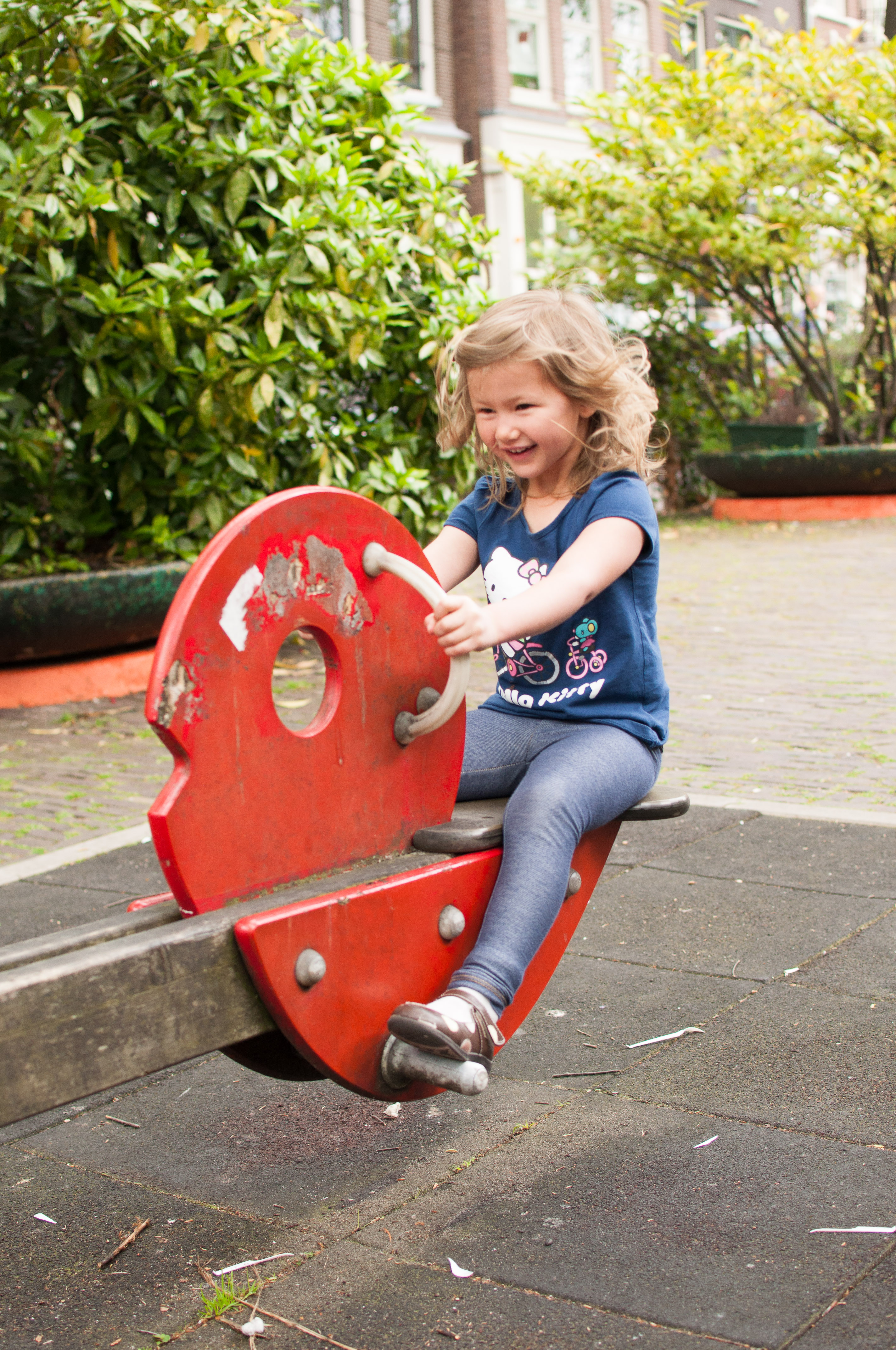Josie on the see saw in Amsterdam