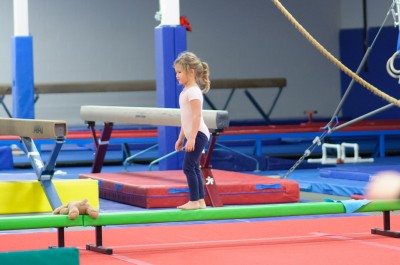 Josie walking backwards on the beam