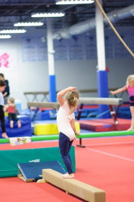 Josie on the low beam, tipping