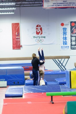 Josie doing a handstand on the beam with help