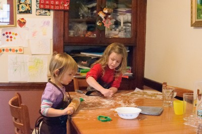 Josie and Celia rolling out cookies