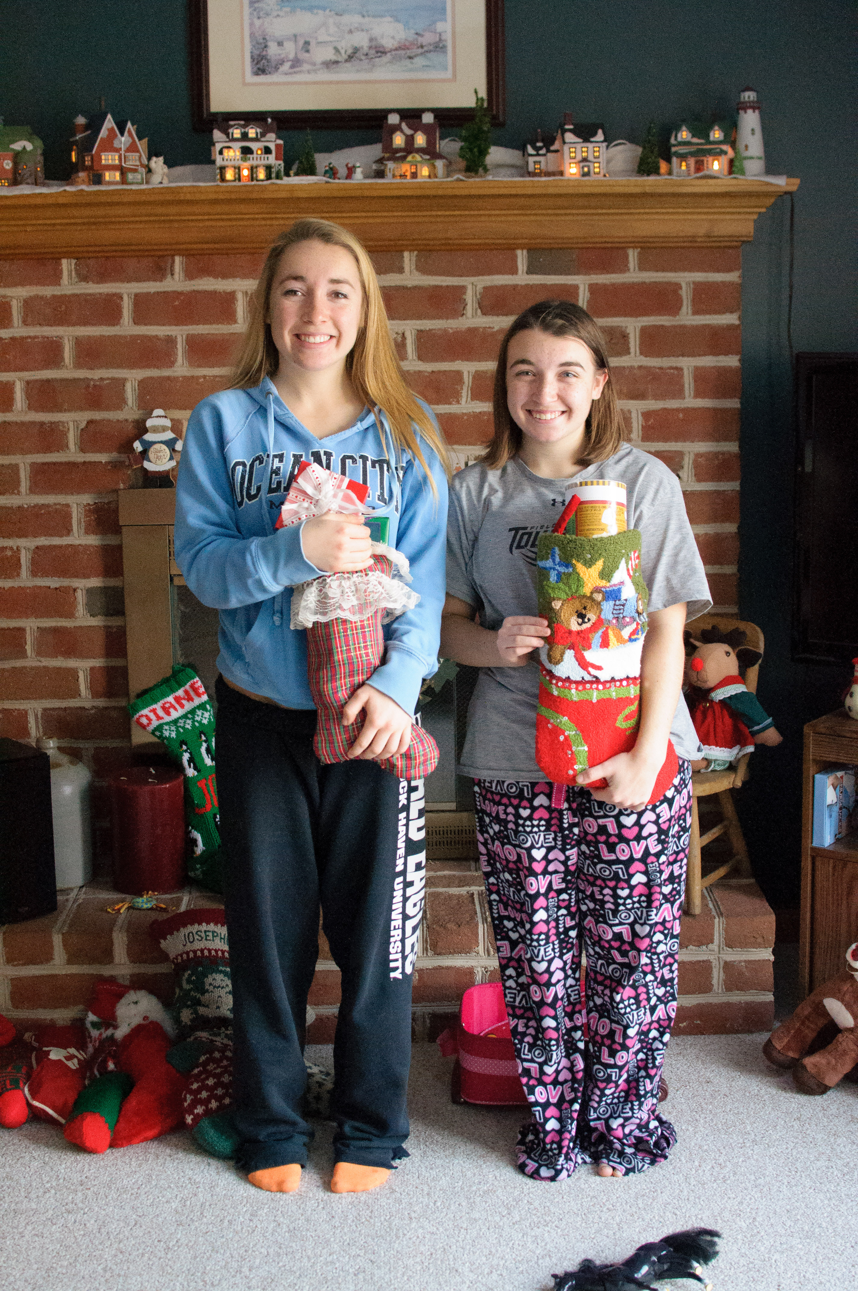 Abby and Ally holding their stockings
