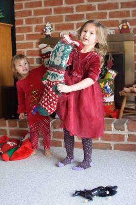 Celia and Josie holding their stockings
