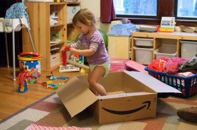 Celia playing in the box instead of the toys