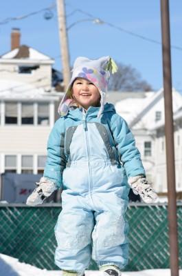 Celia, on top of the backyard snowpile