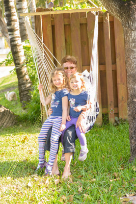 Abuela and the girls in the swing