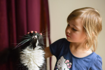 Celia petting Mio