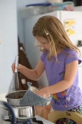 Josie focused on stirring
