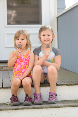 Celia and Josie enjoying their fudgesicles