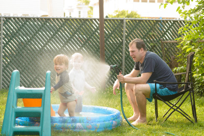 Jason spraying Charlie and Grant