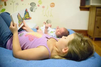 Josie reading to Ewan in bed