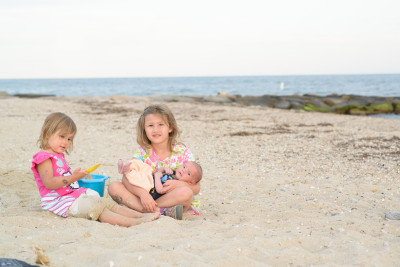 Celia, Ewan and Josie on the beach at night