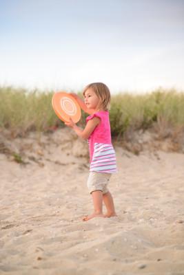 Celia tossing a frisbee