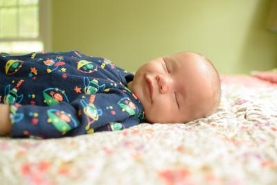 Ewan smiling and sleeping at 7 weeks
