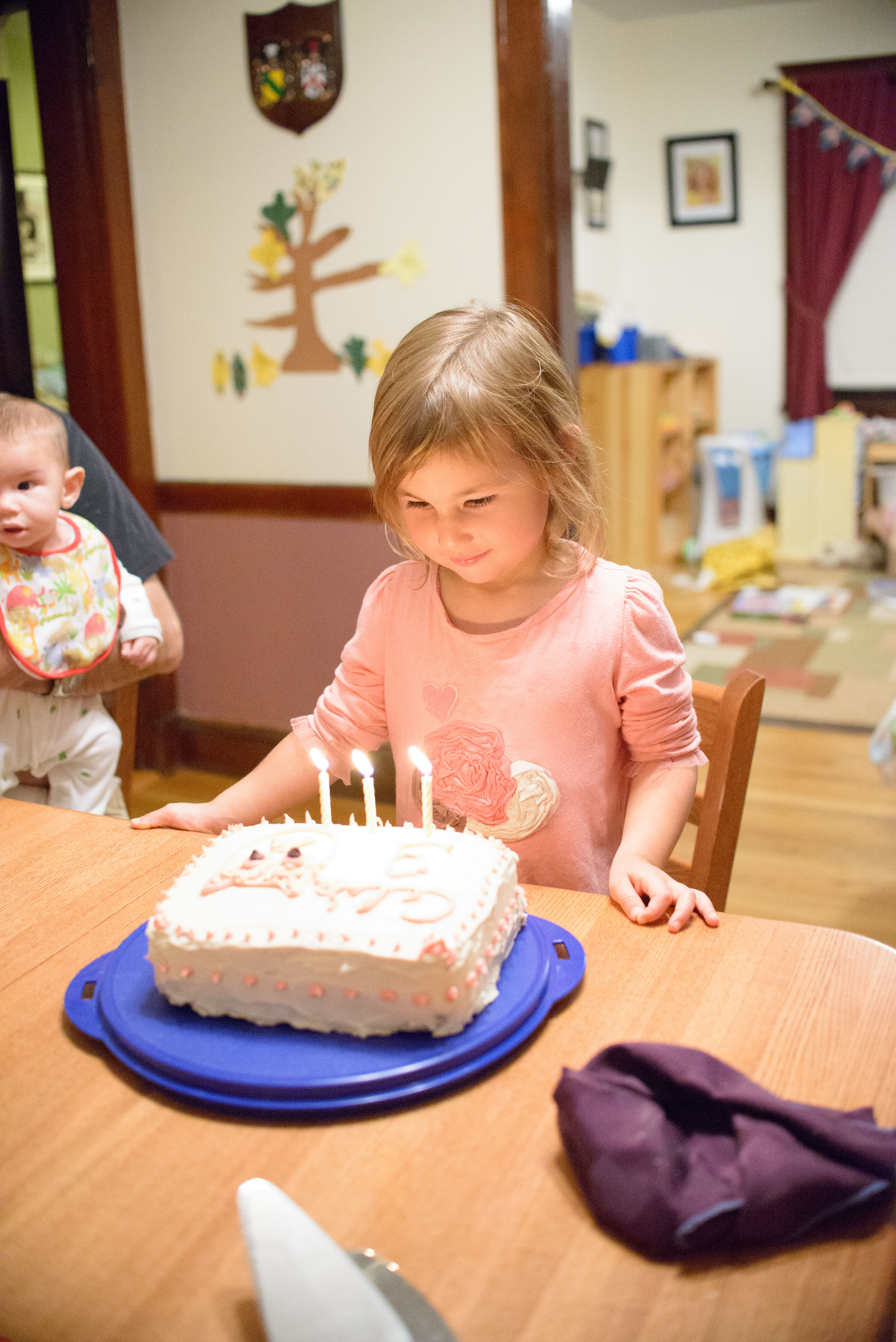 Celia blowing out her candles