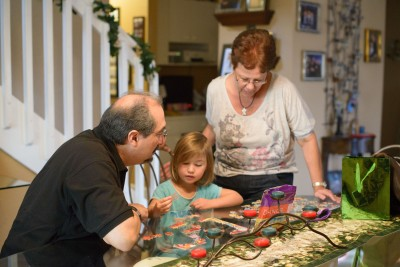 Gilbert, Celia and Tere doing a puzzle