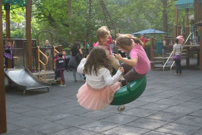 Josie and Celia on the tire swing