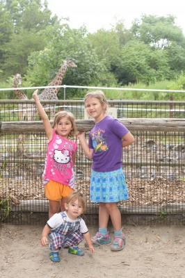 Celia, Ewan and Josie in front of a giraffe