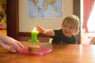 Ewan pointing at his cupcake