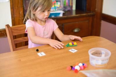 Celia playing the alligator game