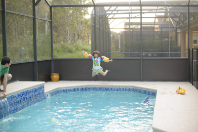 Josie jumping into the pool