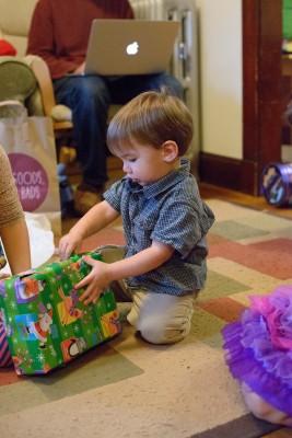 Ewan opening his gift