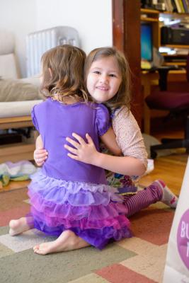 Josie hugging Celia in thanks