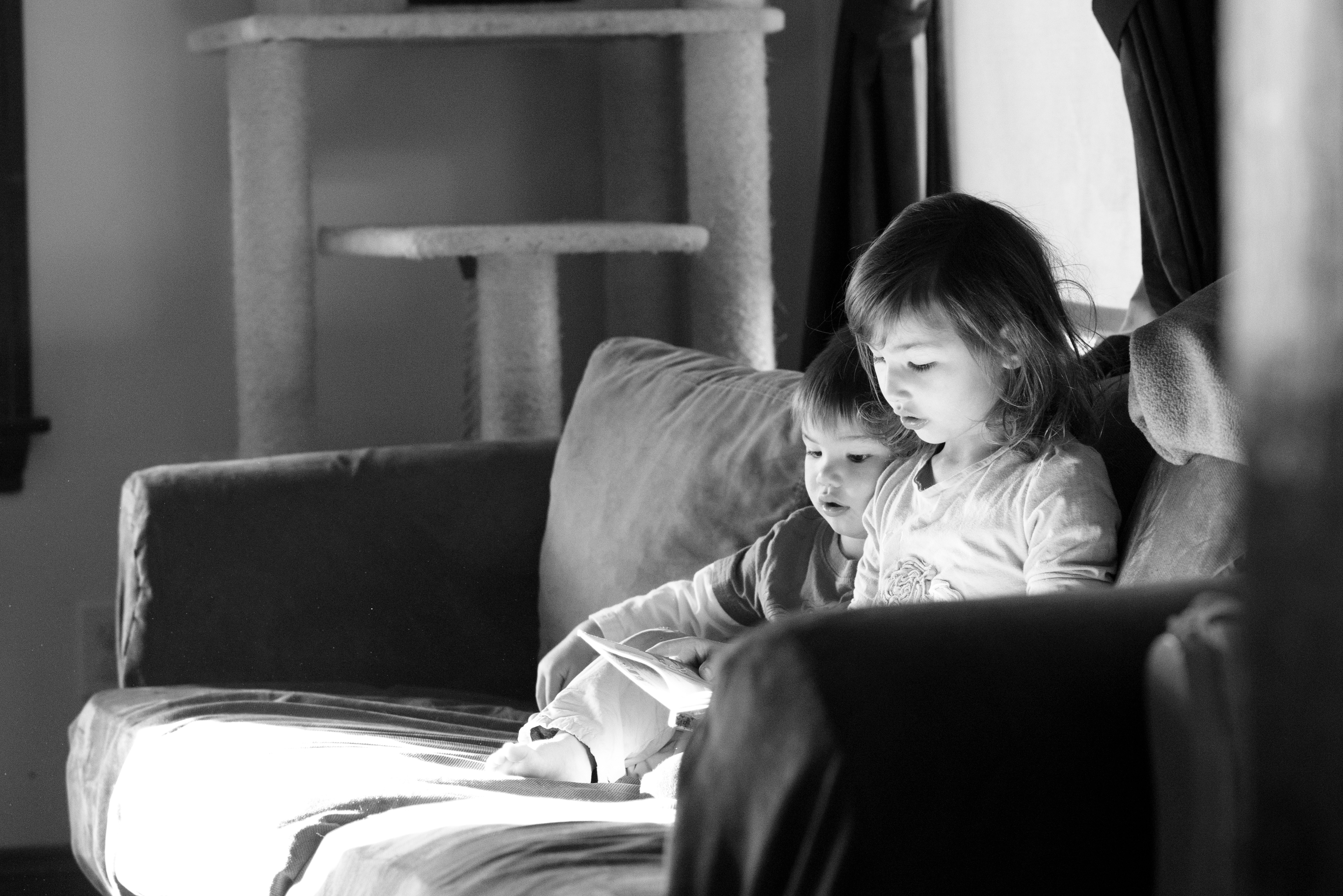Celia reading to Ewan